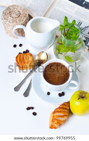 Fresh appetizing breakfast, coffee, pastries and fruits on a white background