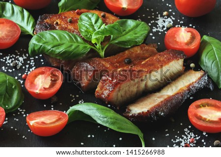 Fresh appetizing meat steak on a board with tomatoes and basil. Keto diet. Paleo diet. Pegan Diet. #1415266988