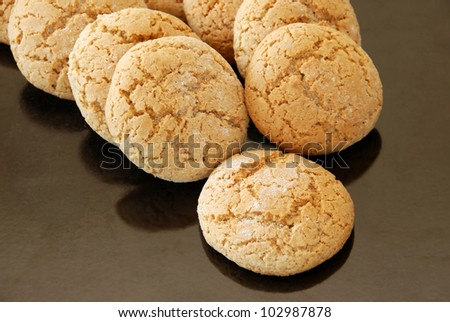 fresh appetizing oatmeal cookies on black oven pan
