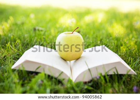 Fresh apple and open book