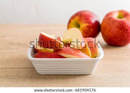 fresh apple sliced in white bowl