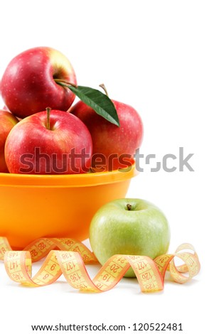 Fresh apples in a bowl and measuring tape isolated on white background.