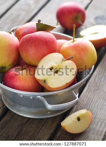 Fresh apples in bowl, selective focus
