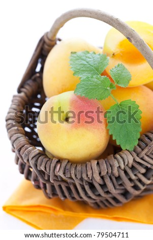 fresh apricots in a basket closeup
