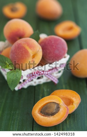 Fresh apricots on green table