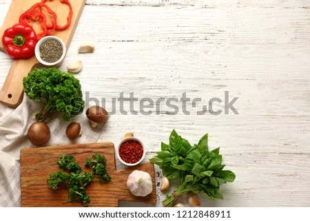 Fresh aromatic herbs with spices and vegetables on white background