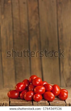 Fresh aromatic plum tomatoes. Plum organic tomatos on market. Italian plum tomatoes. Young juicy tomatoes. Farm market tray full of tomatoes.