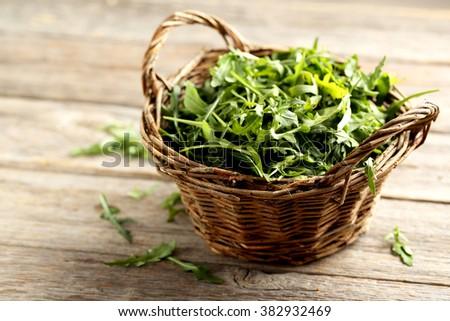 Fresh arugula leafs on a grey wooden table ストックフォト ©