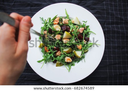 fresh arugula salad with chicken pear and beetroot #682674589