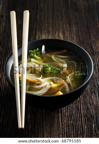 Fresh asian vegetable soup with noodles close up