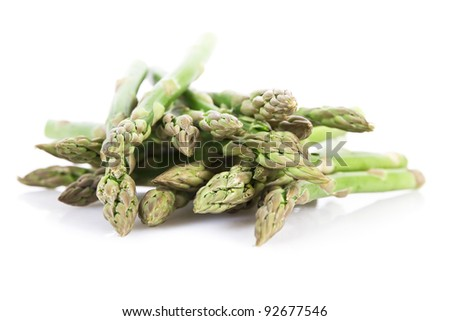 Fresh asparagus isolated over white
