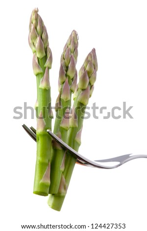 fresh asparagus on fork isolated over white background