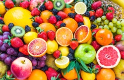 Fresh assorted fruits background.Love fruits, healthy food.
