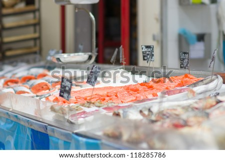 Fresh atlantic salmon lie on table with ice in supermarket