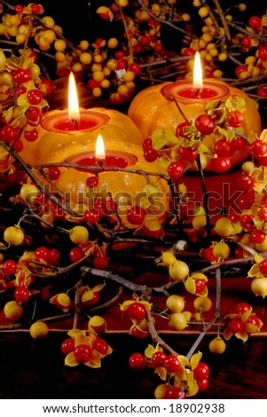fresh autumn bittersweet vines with berries just popped as table wreath; mini pumpkins with candles