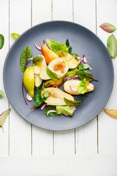 Fresh autumn salad.Appetizing salad with pear and herbs.