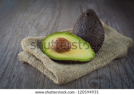 Fresh avocado fruit on a wooden background