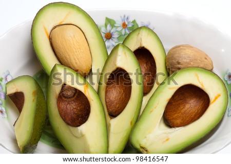 Fresh Avocado Halves On Plate - stock photo