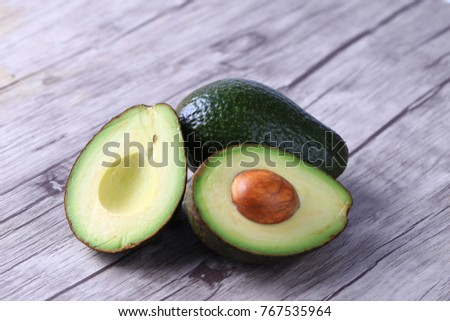 Fresh avocado on a wooden table