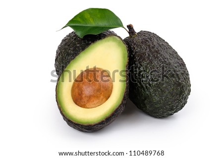 Fresh Avocados two whole and one halved isolated on white