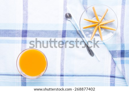 Fresh baby carrots circle explode on blue table mat
