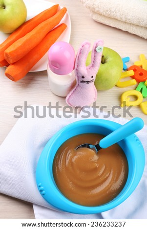 Fresh baby food in bowl with spoon #236233237