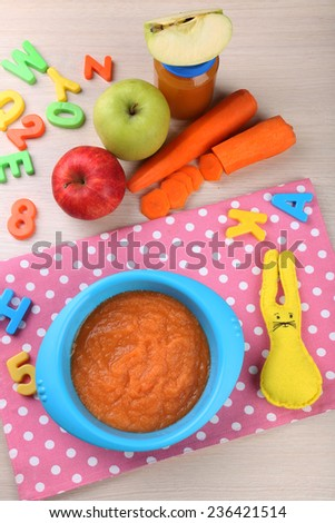 Fresh baby food in bowl with spoon #236421514