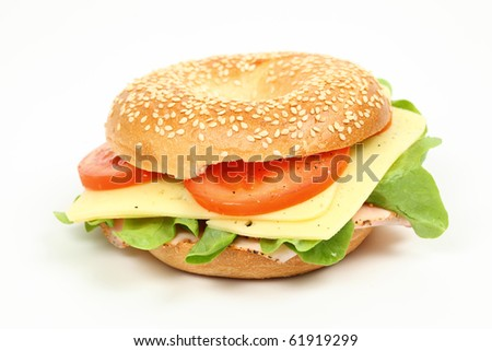 Fresh bagel sandwich over white background