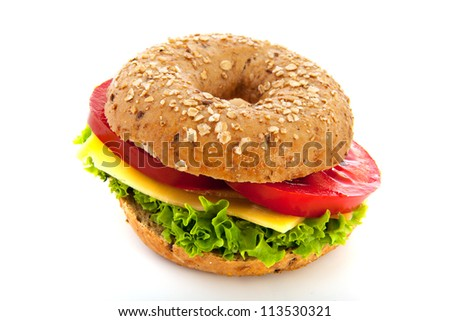 Fresh bagel with cheese and vegetables