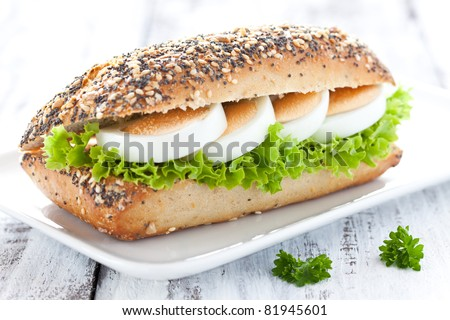 fresh baguette with egg and salad