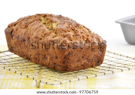Fresh baked banana bread cooling on metal rack in horizontal format