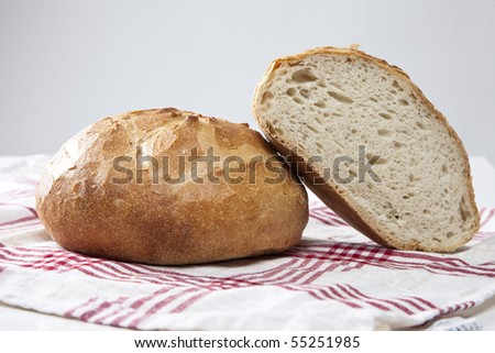 Fresh baked bread on a red and white cloth
