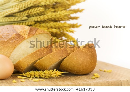 fresh baked bread sliced and grains over white background. With sample text
