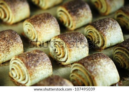 Fresh baked buns with cinnamon and vanilla