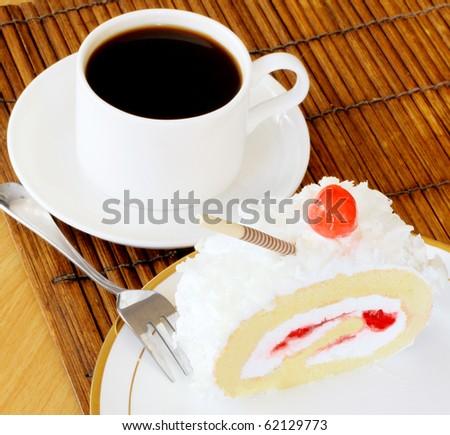 fresh baked cake with white icing, cream and strawberry jam