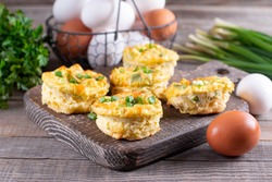 Fresh baked egg bites on a wooden board on a table