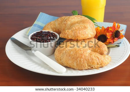 Fresh baked flaky croissants served with jam.