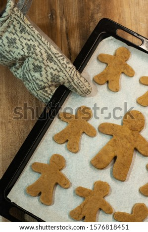 Fresh baked homemade Chritstmas gingerbread cookie on a baking tray. #1576818451
