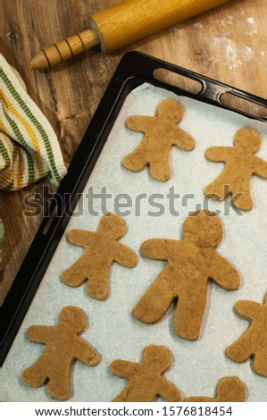 Fresh baked homemade Chritstmas gingerbread cookie on a baking tray. #1576818454