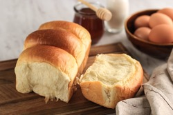 Fresh Baked Japanese Soft and Fluffy Bun White Bread, Popular as Hokaido Milk Bread . Homemade Japanese Brioche