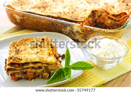 Fresh baked lasagna casserole with a serving cut