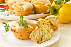 fresh baked muffins with quince and poppy seeds