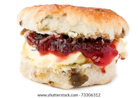 Fresh-baked scone, with strawberry jam and clotted cream. Isolated on white.
