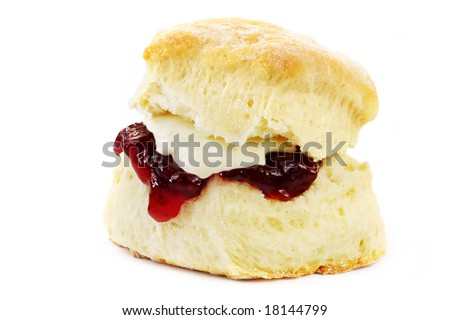 Fresh-baked scone, with strawberry jam and whipped cream.  Isolated on white.  Yummo!