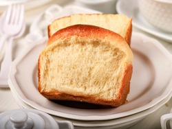 Fresh Baked Sliced Japanese Soft and Fluffy Bun White Bread, Popular as Hokaido Milk Bread . Homemade Japanese Brioche
