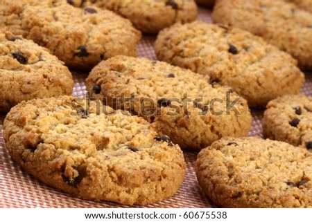 Fresh baked Stack of warm chocolate  chips cookies on baking silicone sheet  shallow DOF
