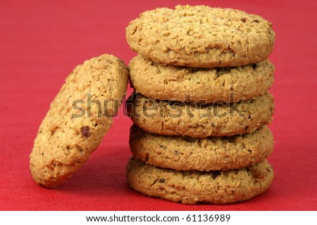 Fresh baked Stack of warm oatmeal cranberry cookies on fine tablecloth made of linen, shallow DOF