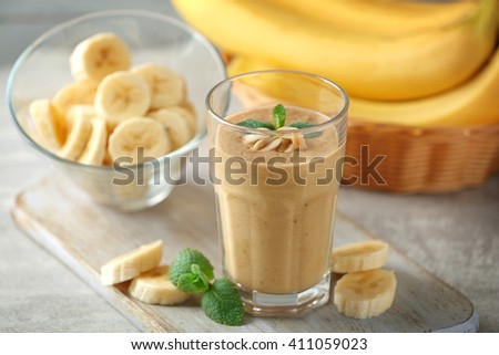 Fresh banana cocktail with peanuts on cutting board