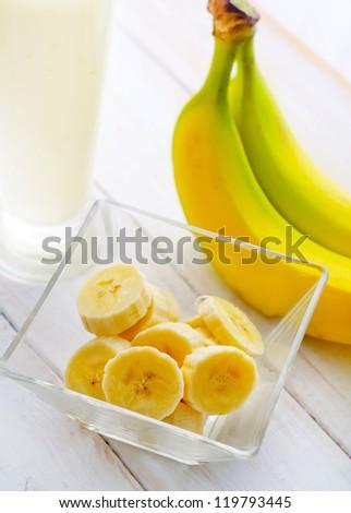 Fresh banana in the glass bowl, banana and milk