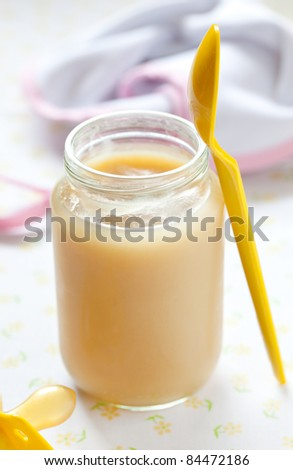 fresh banana puree in a glass with spoon